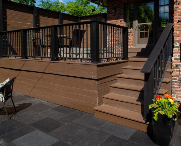 Rosetta Black River Limestone; Deck & Stairs: Azek Brazilian Walnut; Railings & Posts: Contemporary Evolutions in Black